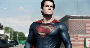 Superman standing in front of American flag