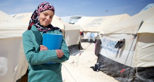 Hana, 16, in the Za'atari refugee camp, wearing the uniform supplied to her by Act for Peace's partner in Jordan, International Orthodox Christian Charities (IOCC)