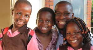 Allan, centre, with Pastor Peter Sewakiryanga and other children saved from child sacrifice by Kyampisi Childcare Ministries