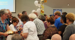 Members share communion during the 31st Synod closing service