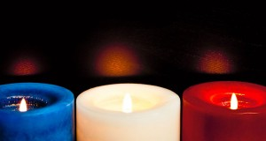 Three candles resembling the French tricolour