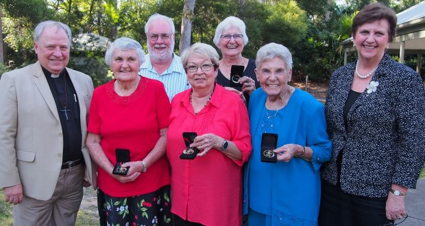 Five recipients of the 2016 Moderator's Community Service Medals with moderator Rev David Baker (far left) and UnitingCare Queensland CEO Anne Cross (far right). Photo by Holly Jewell.
