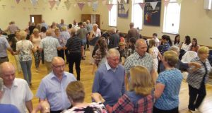 Attendees get into the swing of things at a fundraising barn dance in Greenisland, Northern Ireland. Photo by Eric Lawson.