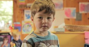 A still of a young boy from documentary The Mask You Live In. Photo by The Representation Project.