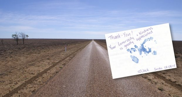 Photo of dry land in the Australian Outback with a thank you card from a farming family.