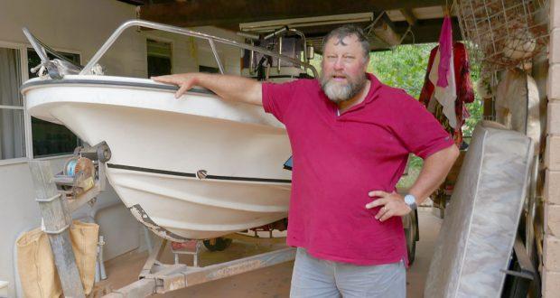 Rev Craig Mischewski with his boat. Photo: John Harrison