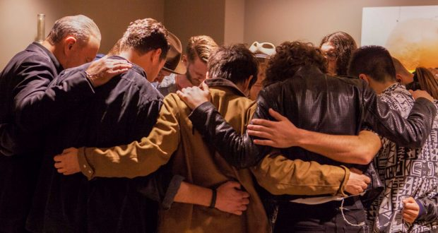 Members of Hillsong United gather to pray before a concert. Photo: Pure Flix