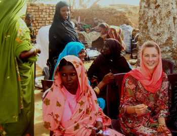Megan McGrath in local dress, with women at Darfur