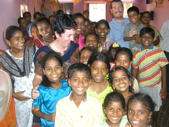 Sue and Alan Pickering with women and children in India in 2007. Photo courtesy of Sue Pickering