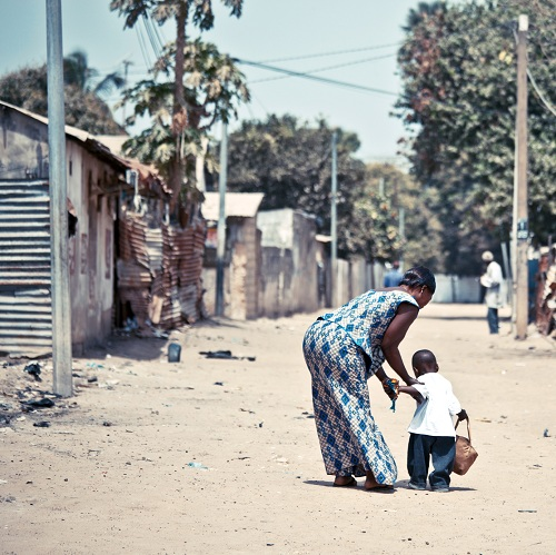 Mother and child on the streets of Jeswang, Gambia. Photo courtesy of iStockphoto