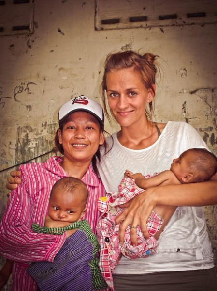 Joanna Herschell-Adair with Neang, one of the women she has supported through pregnancy, and her twins. Photo: Newlife Uniting Church