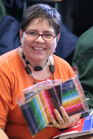 Heather den Houting sorts piles of coloured pencils ready for the backpacks. Photo by Mardi Lumsden