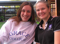 Students Ashley and Roesmary proudly wear the Grace College label