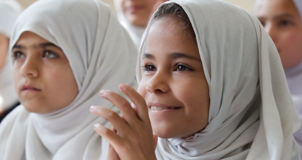 Adela, a nine-year-old Afghan girl in class at Charbagh-E-Safa Girls High School in Jalalabad. Photo by Act for Peace