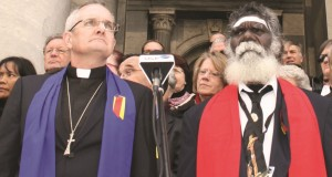 Rev Dr Andrew Dutney and Rev Rronang Garrawurra lament with members of the 13th Assembly in front of Parliament House in Adelaide, 2012.