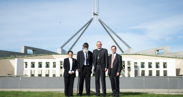 Rev Elenie Poulos, Rev Rronang Garrawurra, Rev Dr Andrew Dutney and Rev Terence Corkin in front of Parliament House, Canberra.