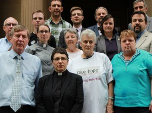 Elenie Poulos and supporters present the Uniting Church offer of sanctuary for unaccompanied minors currently held on Christmas Island.