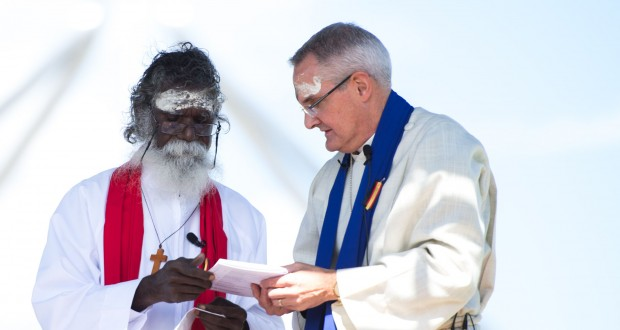 Rev Rronang Garrawurra and Rev Dr Andrew Dutney share communion at the Destiny Together vigil in Canberra.