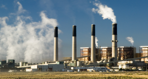 Coal-fired power plant with snoke. Photo by iStock