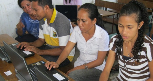 Teachers at Marcelo II School, Dili, using laptops donated to them by Glebe Road Uniting Church. Photo by Noela Rothery.