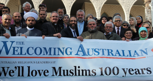 Leaders of many faiths gathered at Lakemba Mosque to express support for Australia's Muslims. Here they hold the 'We'll love Muslims 100 years' banner. This photo was supplied by the Uniting Church Assembly.