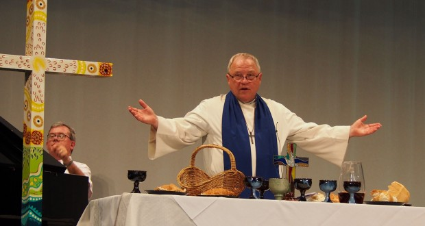 Rev David Baker presides over communion after being inducted as Moderator at the opening of the 31st Synod in Session.