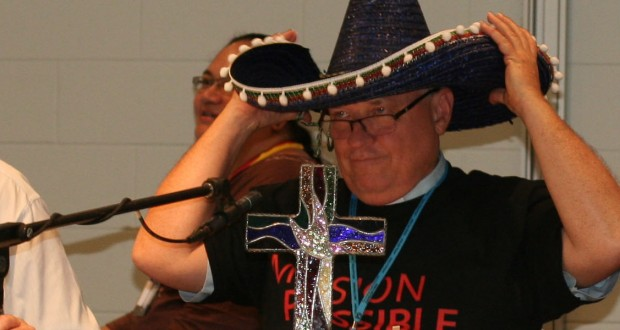 Rev David Baker wears a sombrero to promote Trinity College Queensland's new OLE learning system at the 31st Synod in Session.