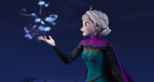 "Elsa from Frozen, mid-singing ""Let it go."" Photo by Walt Disney."