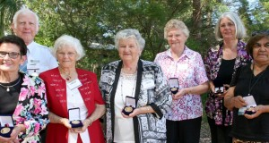 (Left to right) Shirley Wyatt, Don Leckenby, Doreen Coker, Joyce Cunningham, Melva Bryant, Jane Frazer Cosgrove and Aunty Jean Phillips with their awards. Photo by Holly Jewell.