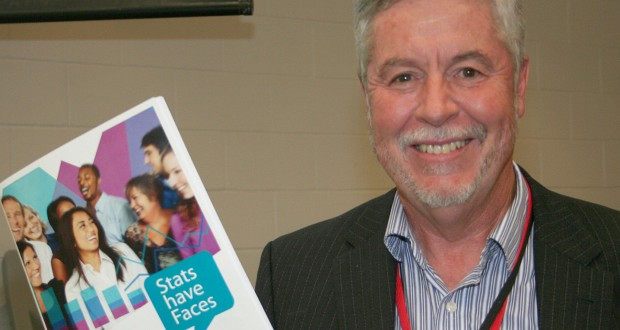 Bruce Mullan holds the newly-launched Stats have Faces resource at the 31st Synod.