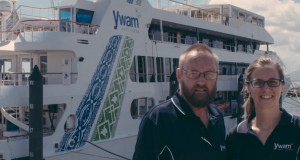 Rev Bruce Cornish and YWAM volunteer Krystal Cochran in front of the MV YWAM PNG. Photo by Ryan Alexander.