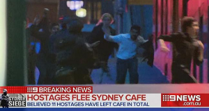 Television still of Sydney siege hostages fleeing Martin Place. Photo by Channel Nine.