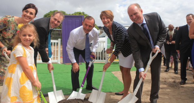 Hummingbird House cofounders Paul and Gabrielle Quilliam turning the sod with their daughter Shiloh, Prime Minister Tony Abbott, Margie Abbott and Wesley Mission Brisbane Executive Director Geoff Batkin. Photo by Wesley Mission Brisbane.