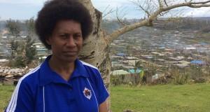 Martha, UnitingWorld gender project officer, standing in front of a devastated Port Vila. Photo by UnitingWorld.