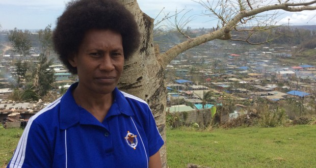 Martha, UnitingWorld gender project officer, standing in front of a devastated Port Vila. Photo by UnitingWorld.