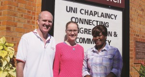 Rev Peter Lockhart (M) with Kate Brazier (R) and Lwanda Kahongo (L) at St Lucia Uniting Church. Photo by Ashley Thompson.