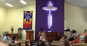 Special guest Pat Morgan sings at the combined Calvary-North Queensland Presbytery service in Townsville.
