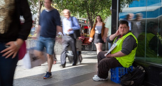 Adam sells the Big Issue on his pitch near the Queen Street Mall.