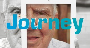April Journey 2016 masthead. Elderly man (Everald Compton) looking at the camera through an iPad.