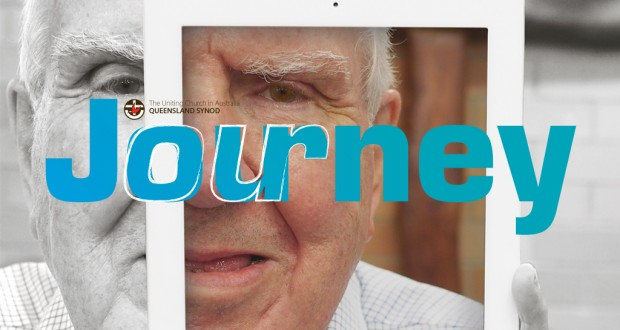 April Journey 2016 masthead. Elderly man (Everald Compton) looking at the camera through an iPad.