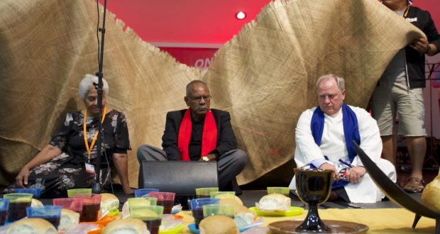 Deaconess Terani Lima, Rev Dennis Corowa and moderator Rev David Baker take part in a Samoan symbolic time of confession. Photo: Ben Rogers