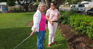 Cynthia Culleton (left), one of the creators of the Wulguru Uniting Church garden, with fellow cancer centre volunteer and congregation member Barbara Coates. Photo: Brian Venten