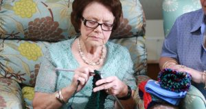 Dell, a resident at Wesley Mission Brisbane Jacobs Court Aged Care Community in Sinnamon Park, Brisbane, knitting for an aged-care facility in Shandong province, China. Photo was supplied.