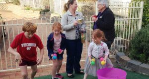 Jean Pyle chatting to a parent while families wait for children at dance classes. Photo was supplied.