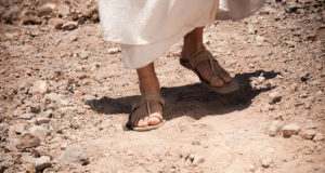 Feet on dusty road